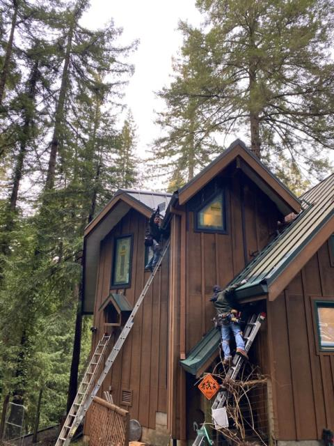 Monte Rio, CA - Working hard in Monte Rio! 106 feet of Gutter Helmet is now protecting this beautiful home from debris and clogging so owners can enjoy the pine trees worry-free!