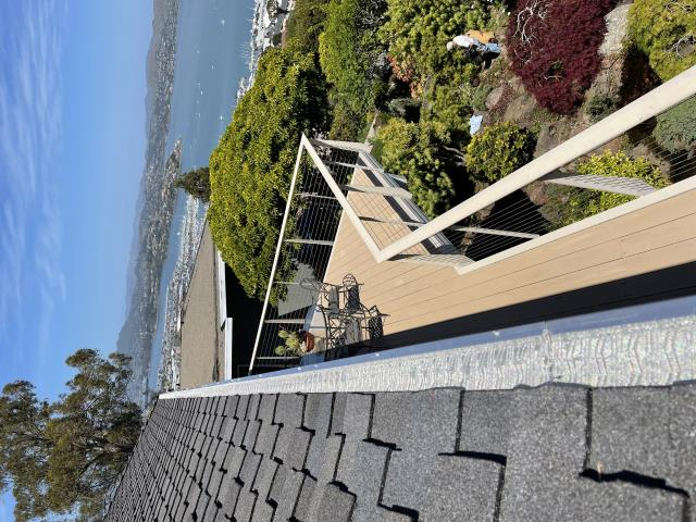 Sausalito, CA - Views like these almost make the roof seem less hot! Our crew installed 180 ft of gutters and stainless steel micro-mesh to protect this home in sunny Sausalito. Great for homes that get light debris!