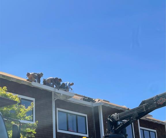 Novato, CA - Working hard on a gutter removal in Novato! This building will have all its gutters reinstalled next week after roofing is completed. All part of the process!