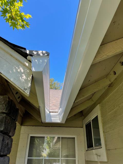 Santa Rosa, CA - This was a tight fit but our guys got it done! This Santa Rosa residence now has 140 feet of Gutter Helmet keeping its gutters free and clear, which will keep this little turn from becoming an all-out waterfall come winter. No matter what unique turns your gutters take, Gutter Helmet can fit them!