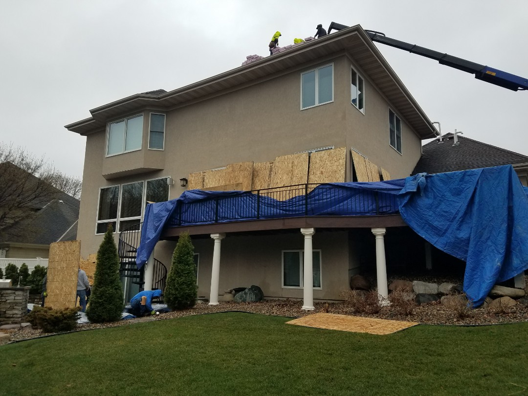 Chanhassen, MN - A good roofing contractor protects siding and windows during re-roofing!