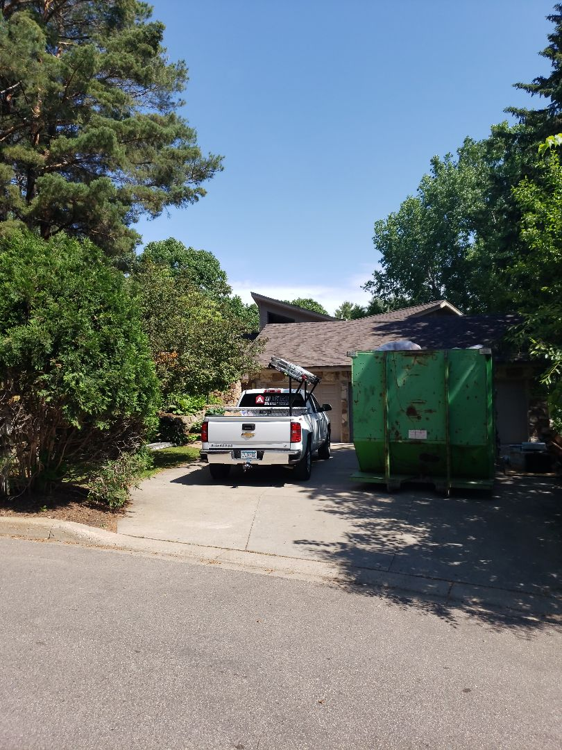 Minneapolis, MN - Full roof replacement with Owens Corning asphalt shingle, re-deck, and replacement of fiberglass insulation to a closed cell spray foam insulation.