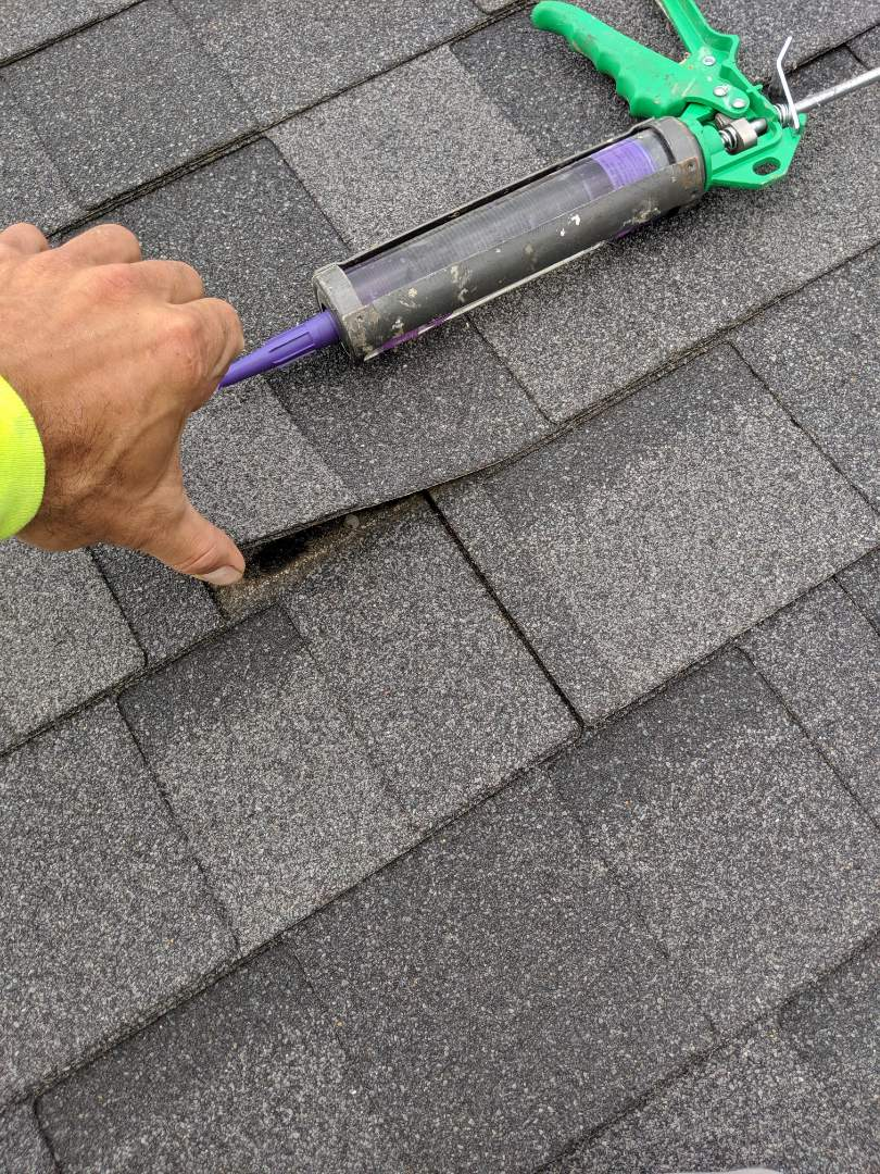 Shakopee, MN - Inspecting reported roof leak. Inspected interior, attic, and roof. Found issue to be unsealed shingles.