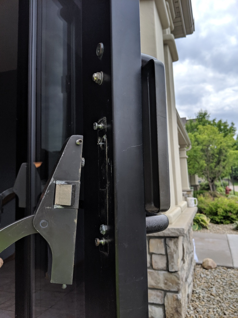 Lakeville, MN - Broken commercial door handle. Took it apart and installed new hardware. Back to working order
