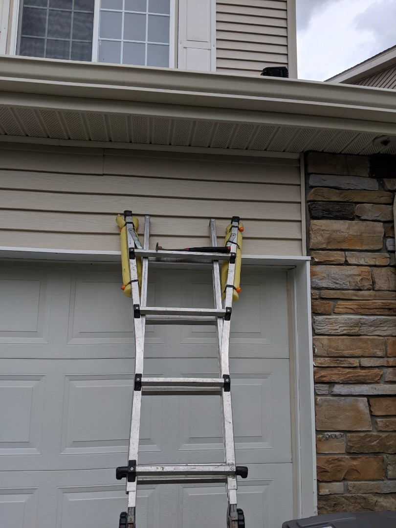 Lakeville, MN - Refastening a loose piece of vinyl siding.