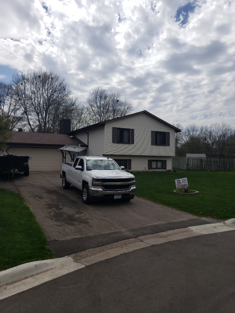 Burnsville, MN - A beautiful new roof for a storm damaged home installed by Allstar Construction Residential using Owens Corning Duration in Sedona Canyon.