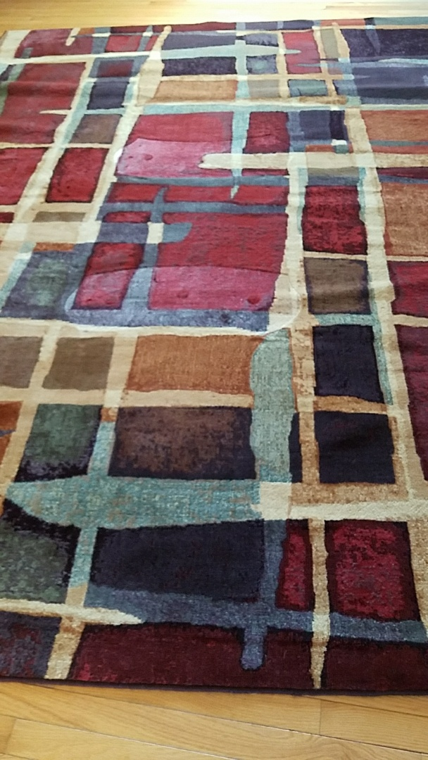 We still have customers that didn't know that we clean Oriental rugs in home. Look at how bright and vibrant this Persian rug is now! Our patented technology allows for us to do that without damaging the wood underneath.