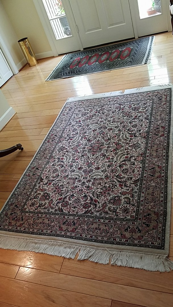 After a good cleaning and treatment these Oriental rugs look and smell great! No more cat smell!