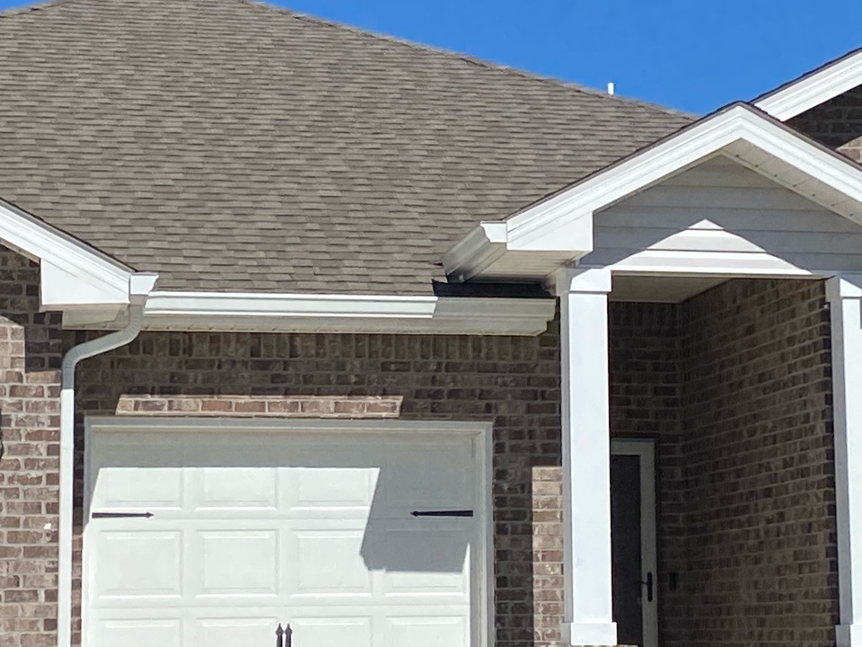 Installed a white 6 inch k style gutter with down spouts made by Senox Corp