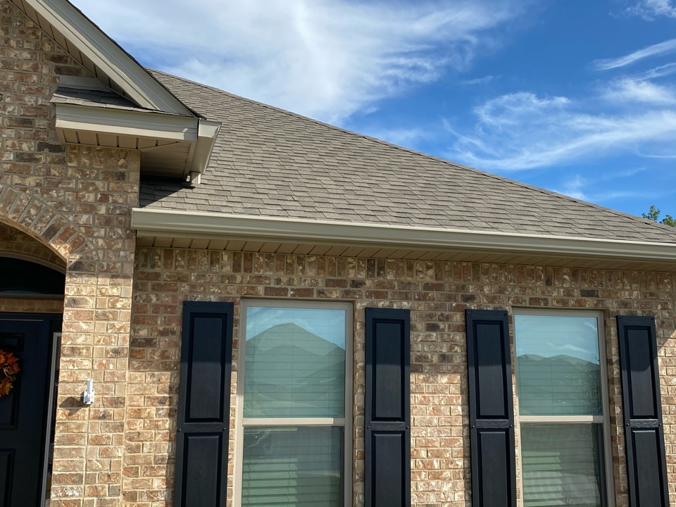 Installed 6 seamless gutters clay color with down spouts