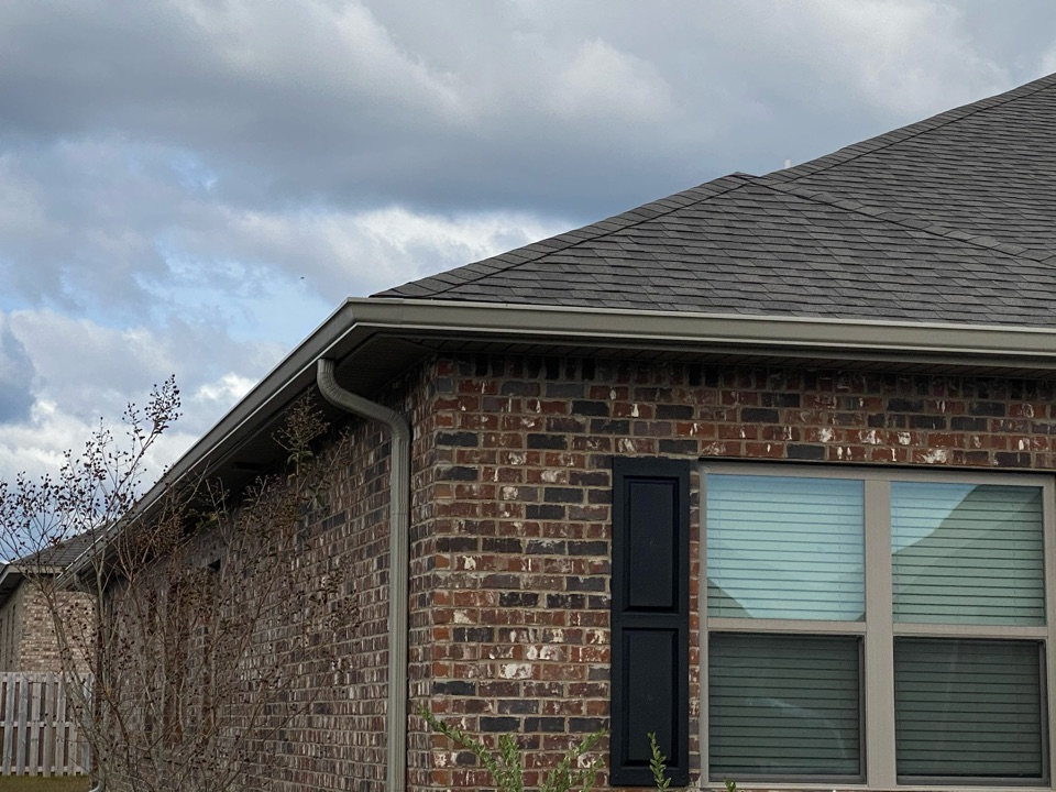 Installed 6 inch seamless gutters in k style with downspouts clay color made by Senox Corp .
