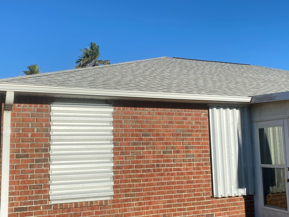 New 5 inch seamless gutter with down spout in white color .   New vinyl soffit and fascia metal added as well