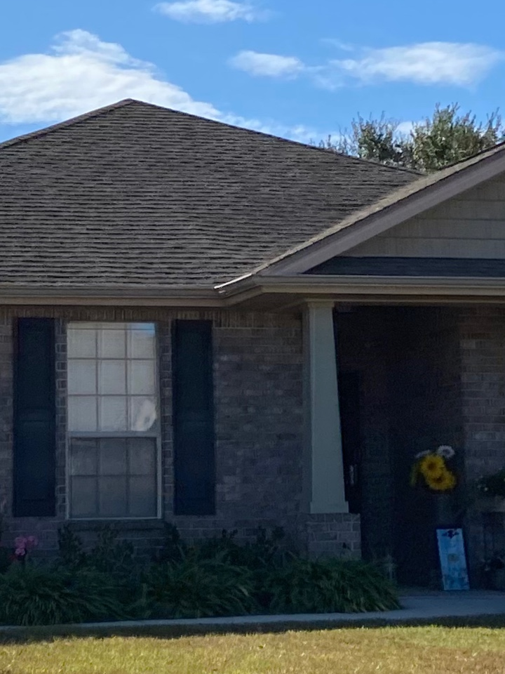 Installed a 5 inch seamless gutter with downspouts in clay color k style gutter