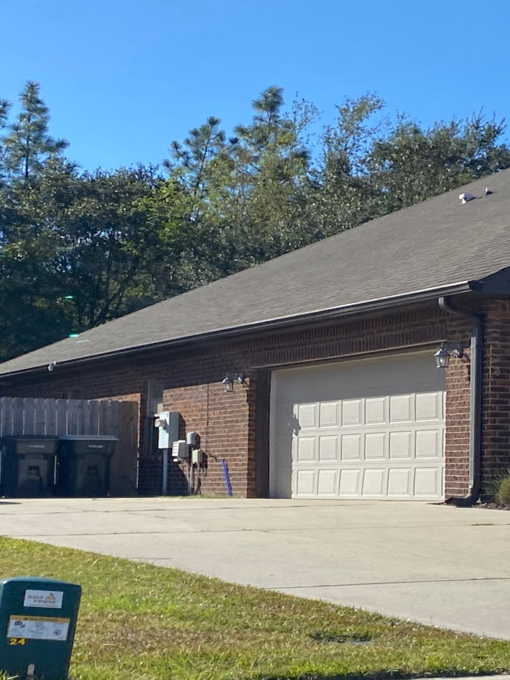 Milton, FL - Installed a 6 inch case style Seamless gutter in the bronze color with new downspouts