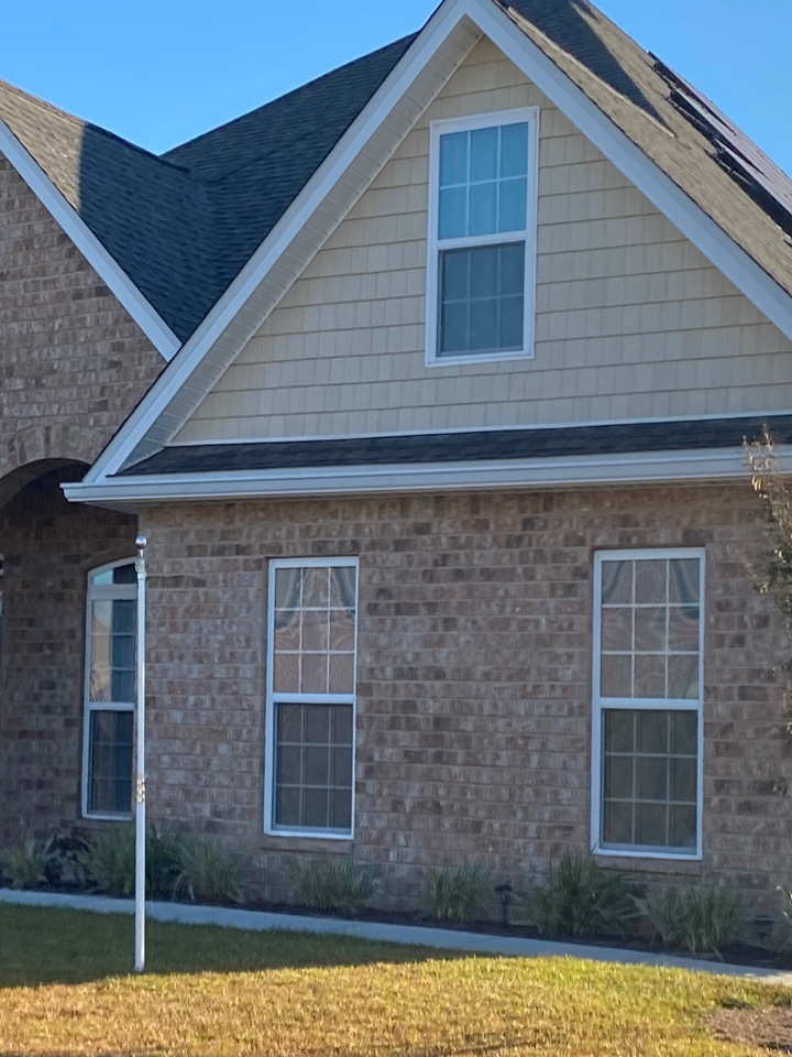 Installed a white 6 inch seamless gutter and downspouts
