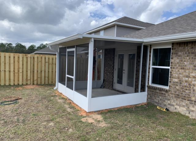 """Enjoy your backyard this Spring with a brand new screen room. Our team built this screen room for a customer in Redstone Commons neighborhood, Crestview FL. From pouring the foundation to installing 6"""" k-style seamless white gutters, giving it that finished look. Looks like this Spring and Summer is going to be cool and dry for this family!"""