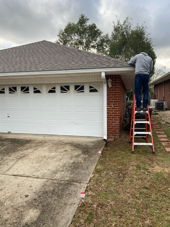 Gutter repair and gutter cleaning .   We cleaned these seamless gutters and installed a leaf filter gutter guard.