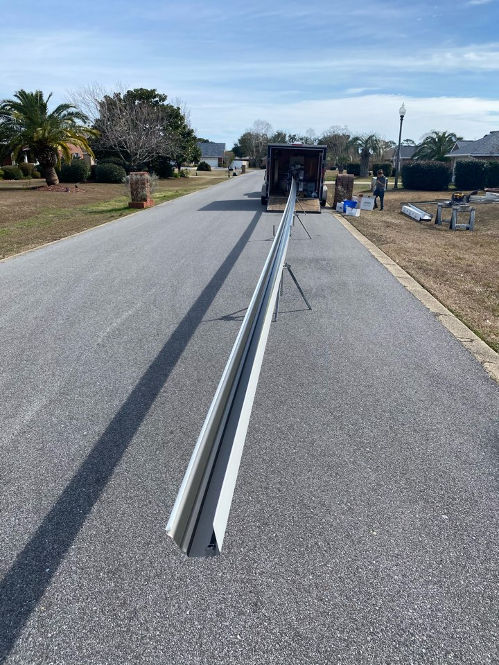 Navarre, FL - This is what we mean by a seamless gutter what ever the length of your houses we can make one solid piece without having any joints in it. This one here is almost 70 feet long long.