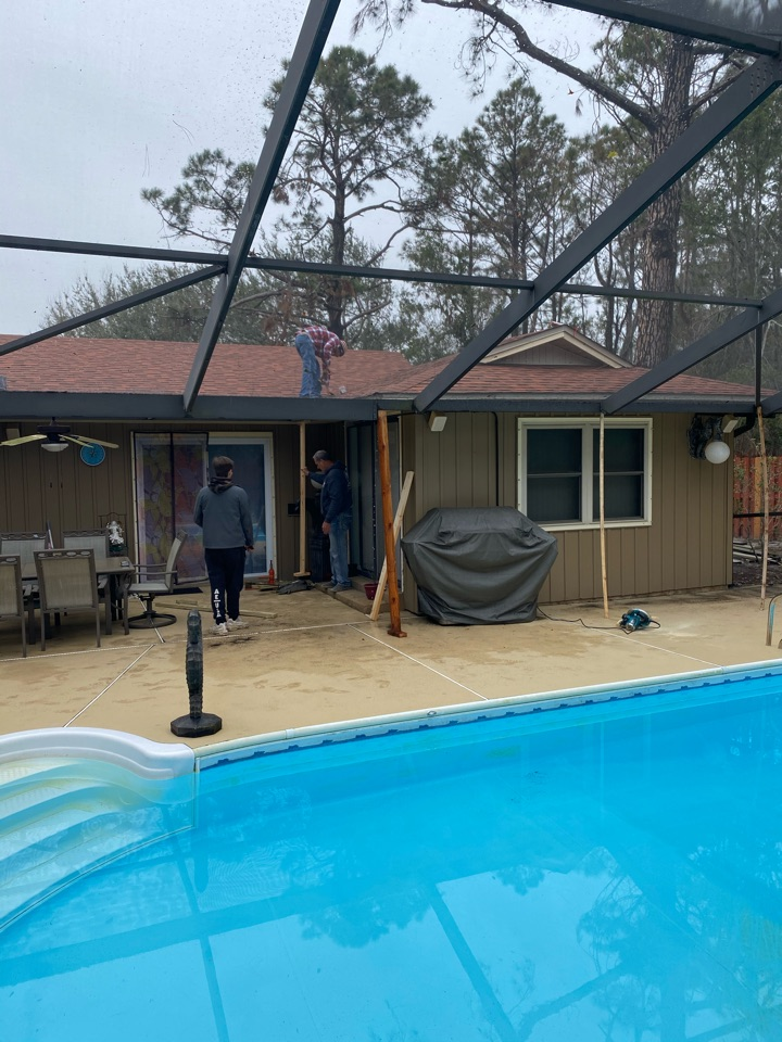 Pensacola, FL - This customer has a damaged pool cage super gutter from the hurricane. We are re-positioning and making the water flow in the proper direction