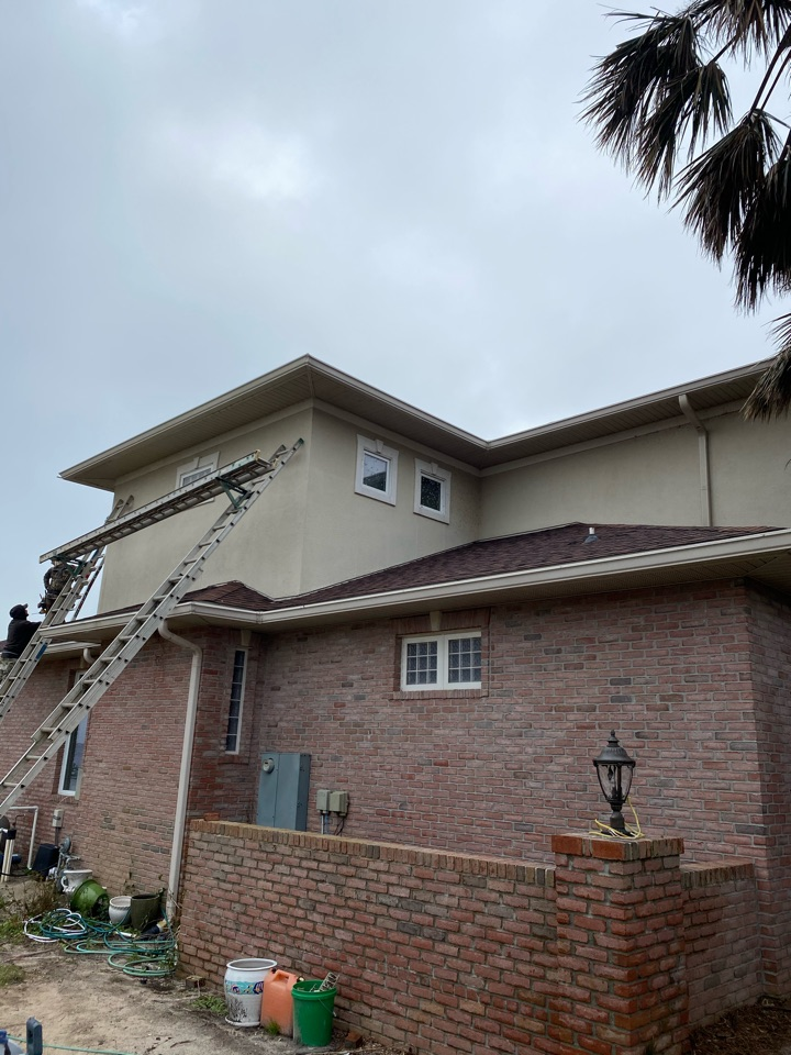 Pensacola, FL - Installing new vinyl soffit, facia metal, new seamless gutters on this home in Pensacola Florida