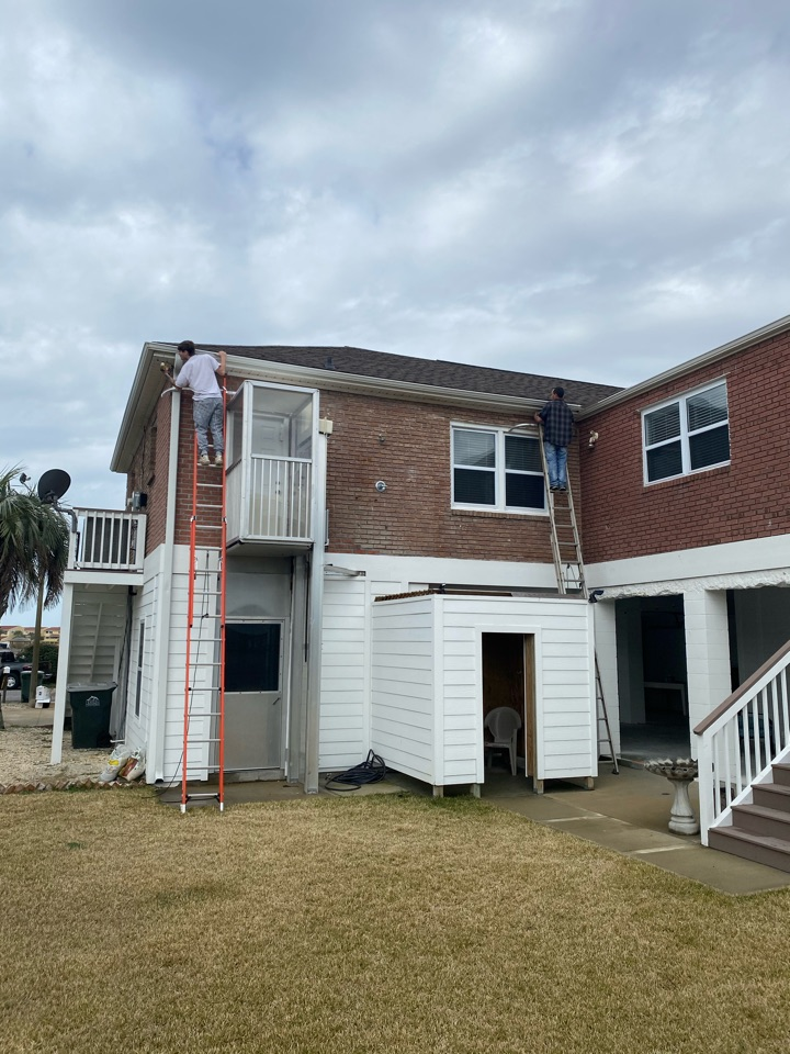 Replacing these old 5 inch gutters and installing a 6 inch seamless gutter on this home on Pensacola Beach