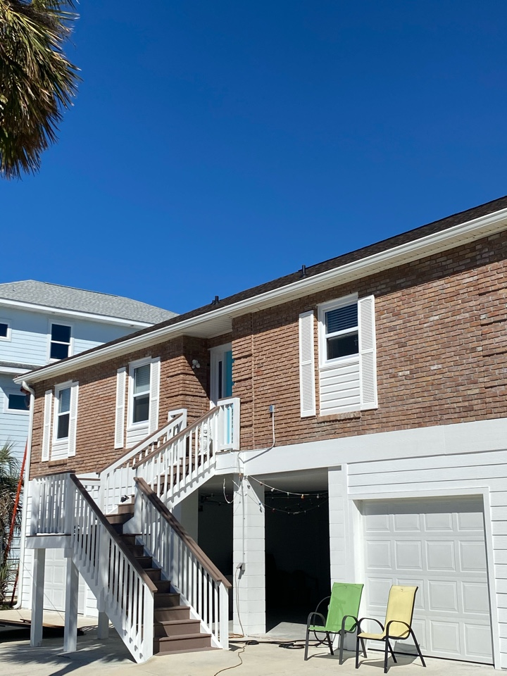 Installed new 6 inch seamless gutters and downspouts on this home in Pensacola Beach Florida