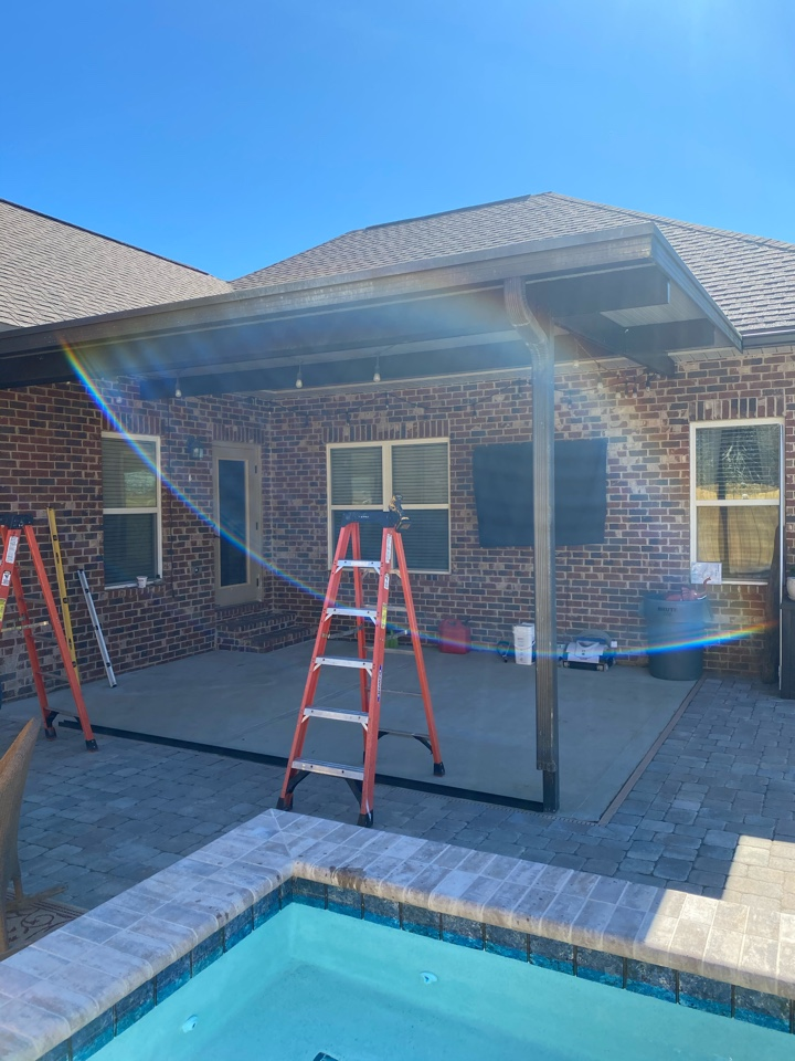 Destin, FL - Installing a new screen room in bronze color on this home in Destin Florida, this will ensure that all the bugs are kept out of his patio area this summer.