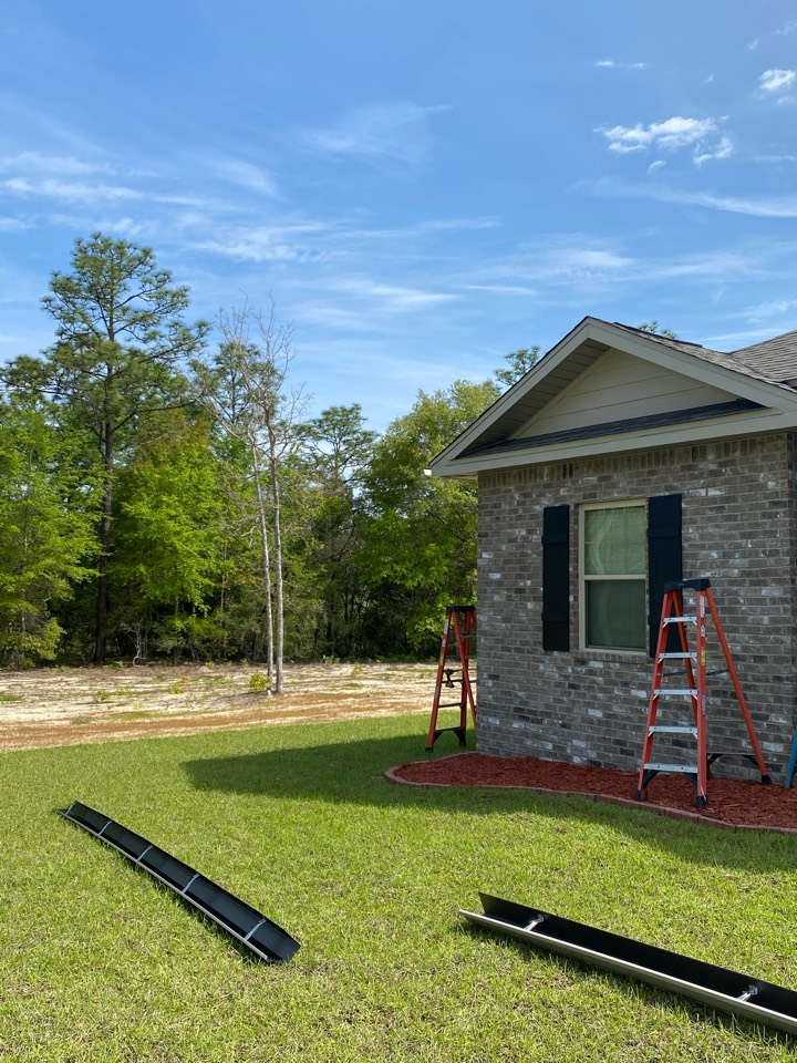 Crestview, FL - Installing new 6 inch seamless gutters and downspouts on this home in Crestview Florida