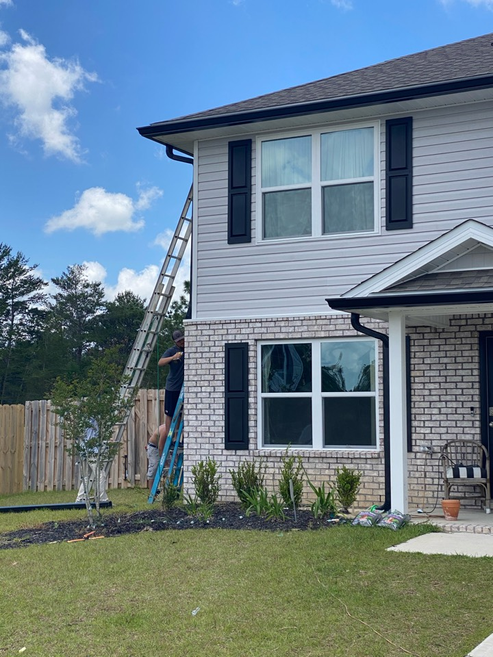 Crestview, FL - Installed new 6 inch seamless gutters and downspouts in black color on this home in Crestview Florida