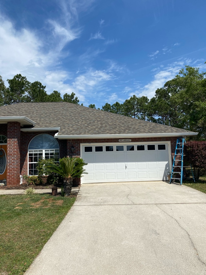 Gulf Breeze, FL - Installed new 6 inch seamless gutters and downspouts on this home in Navarre Florida