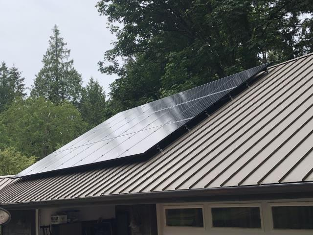 Clinton, WA - Working on a solar installation at a residence in Clinton, WA