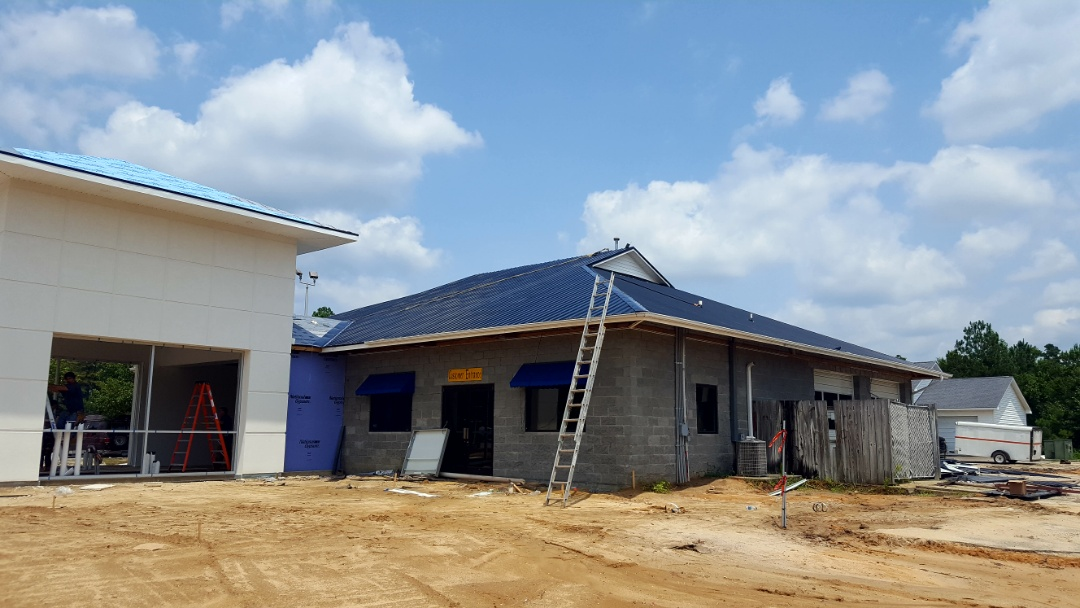 Lumberton, NC - Installing a lifetime metal roof for a new carwash being built.