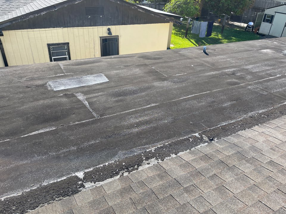 Orlando, FL - Flat roof is failing. Insurance company is dropping coverage. Need to help one of our first and loyal customers with a new roof