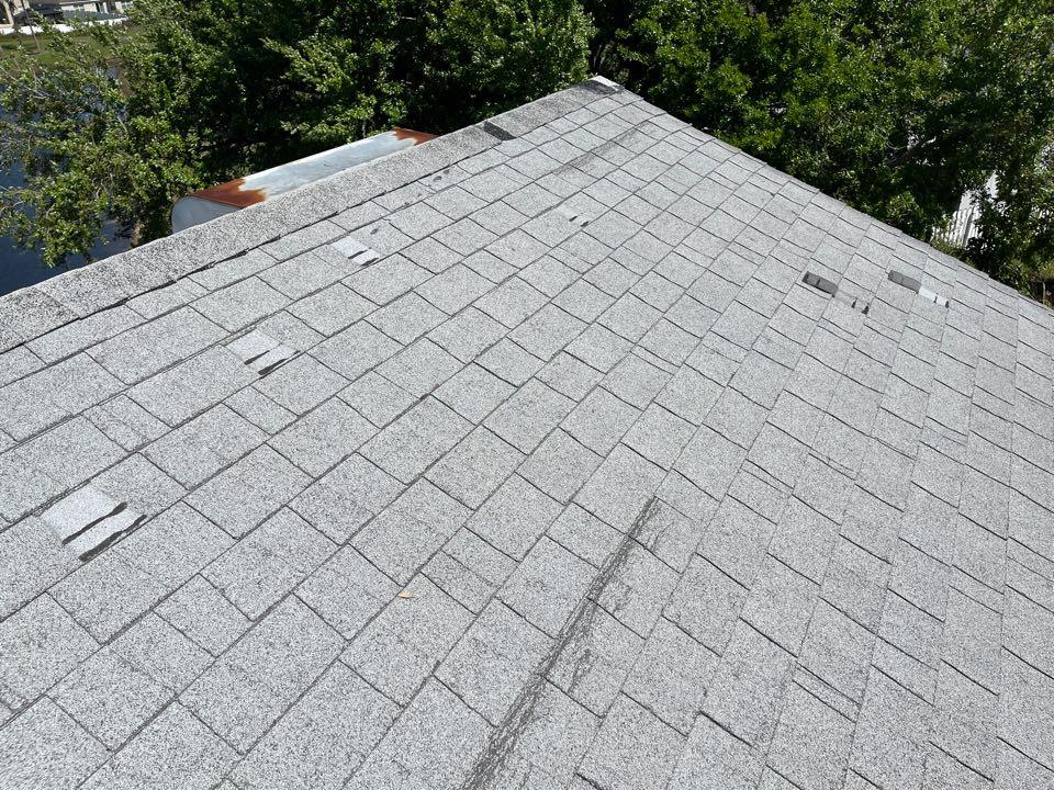 Orlando, FL - Wind damaged roof customer needs a new shingle roof