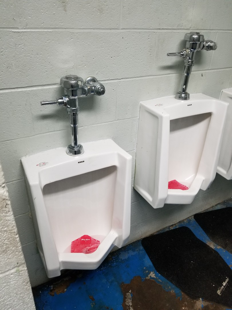 Memphis, TN - Working on urinals