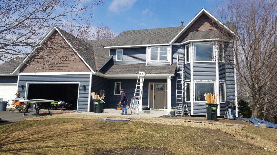 Woodbury, MN - Installing new vinyl replacement windows for a homeowner. Windows are Revere brand windows.