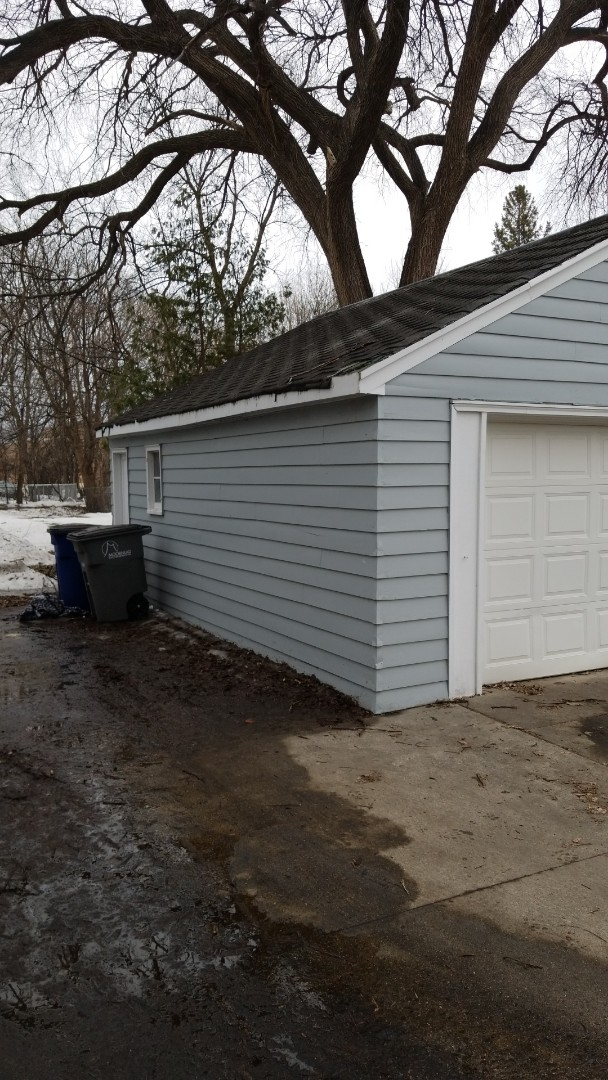 Moorhead, MN - Providing the homeowner with an estimate for asphalt shingle roof replacement