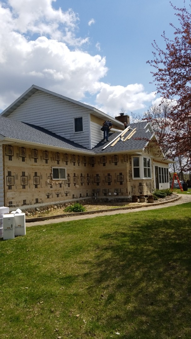 Lake Park, MN - Homeowner is looking forward to their new James Hardie Cement Board, Arctic White to be completed. No More WODPECKER Issues