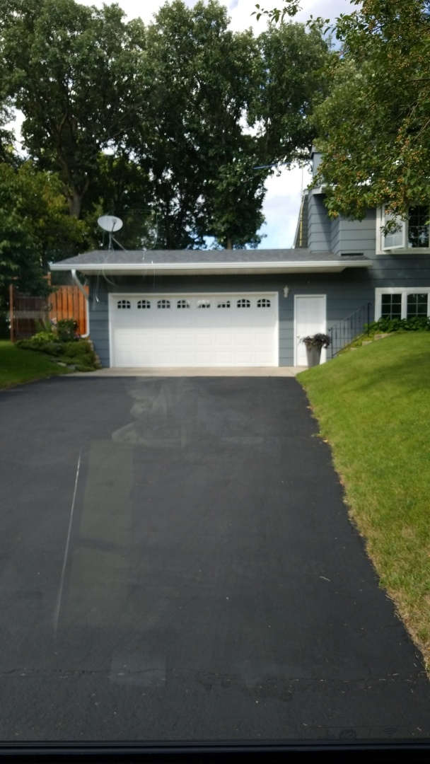 Detroit Lakes, MN - Homeowner is enjoying his lower insurance rate with his hail resistant Owens Corning shingle.