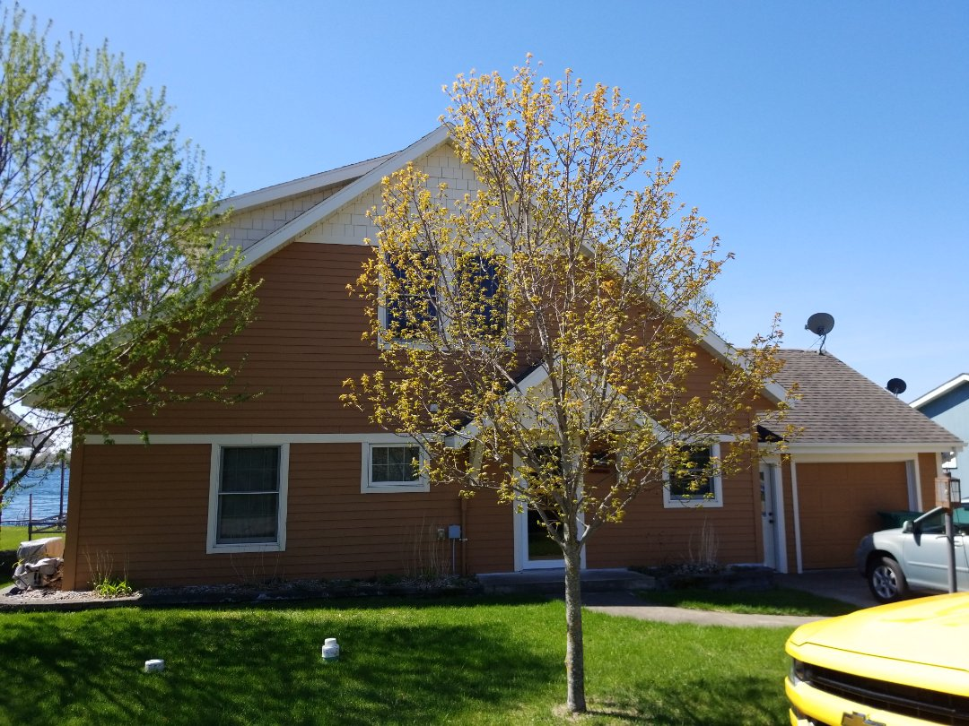 Audubon, MN - Providing a free estimate for James Hardie siding, replacement shingle roof and vinyl replacement windows