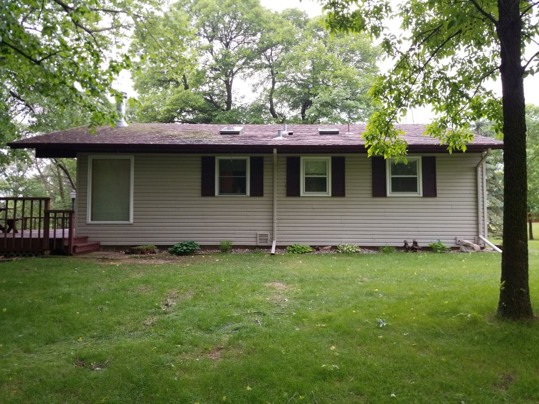 Dent, MN - Providing a free estimate for replacement shingle roof, seamless gutters, soffit and facia replacement
