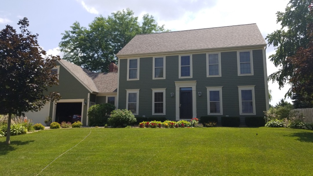 Stillwater, MN - New James Hardie siding in heathered moss color and new Owens Corning shingles with 59 year warranty