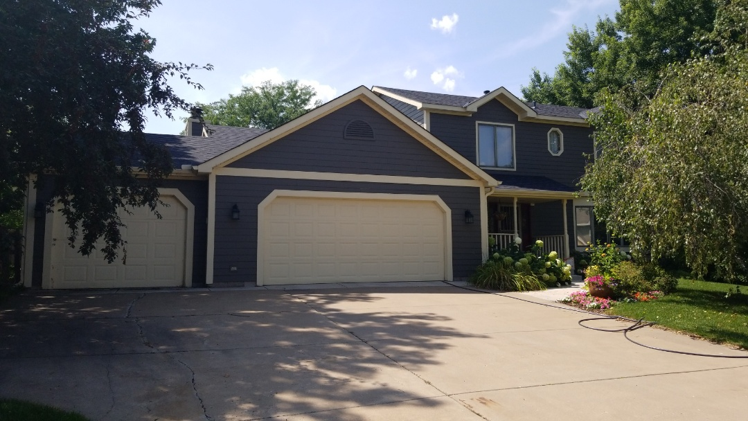 Stillwater, MN - New James Hardie siding in a custom color with Owens Corning duration black singles