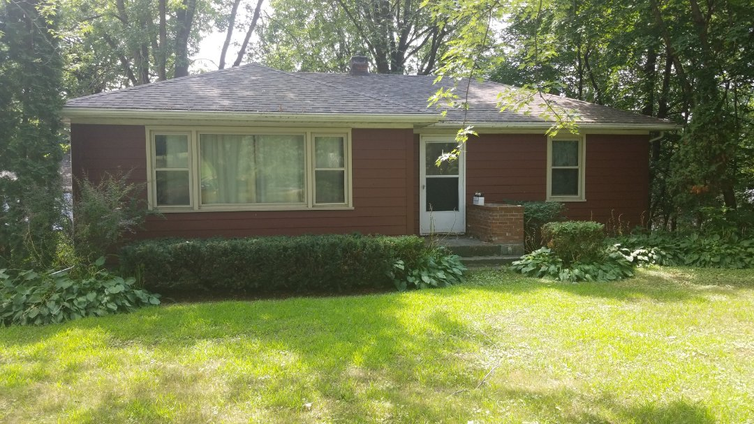 Hudson, WI - New James Hardie siding in Country Lane Red