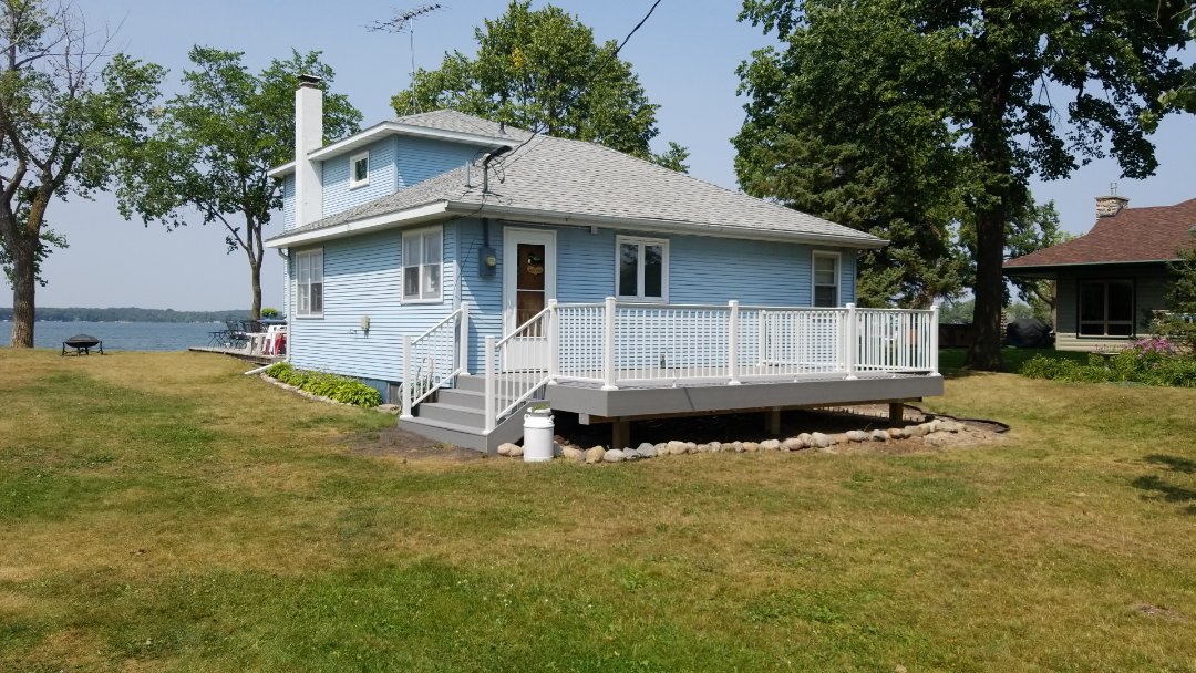 Detroit Lakes, MN - The home owners are able to enjoy years of use with their new maintenance free Trex Deck, Pebble Gray and White Aluminum railing