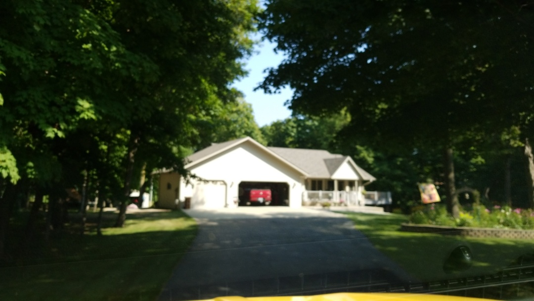 Detroit Lakes, MN - Home owner chose Owens Corning, Duration shingles,  Driftwood color.