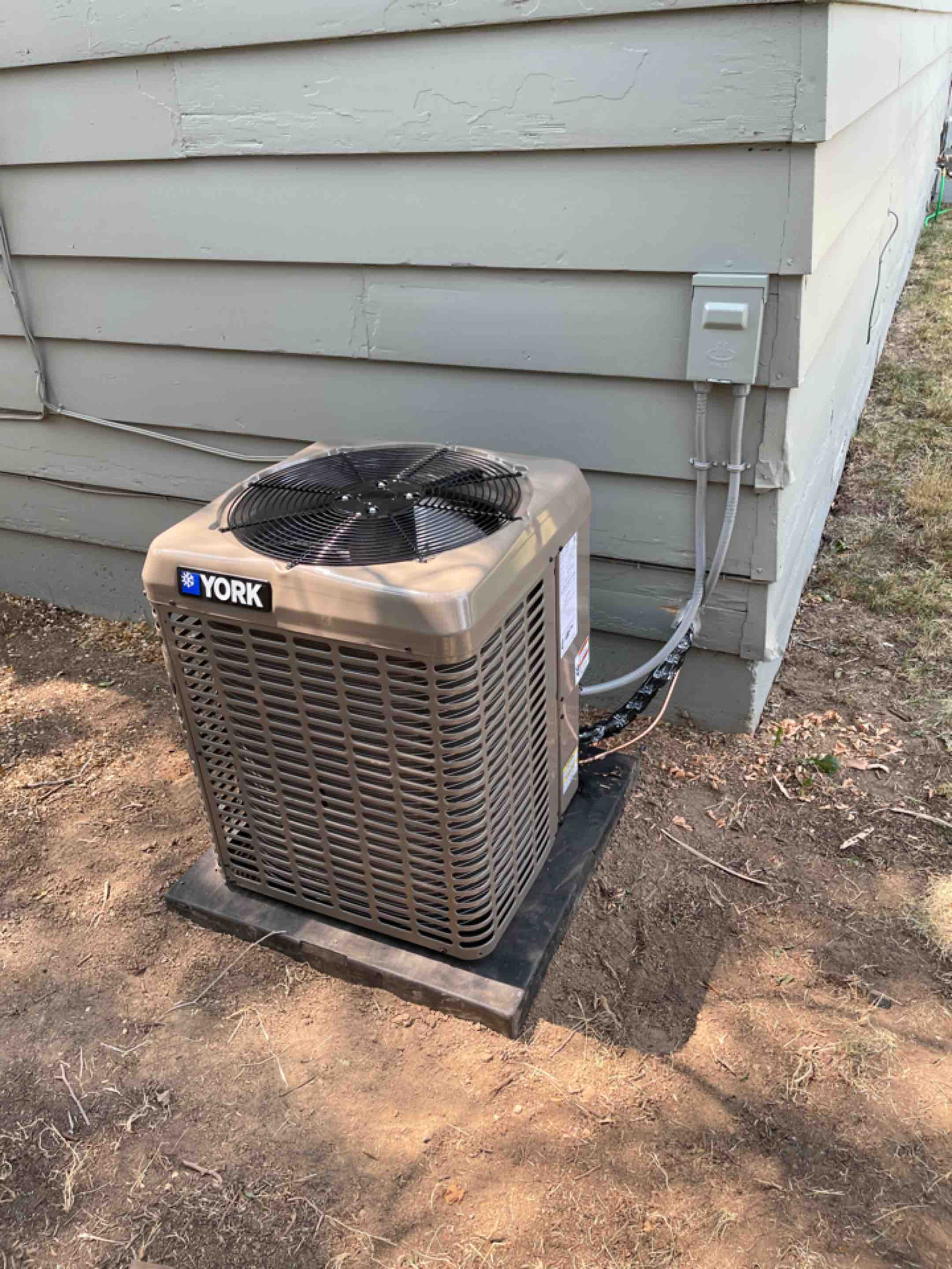 Boise, ID - New York AC installed today. Relocated to back side of the house.