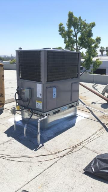Ontario, CA - Replaced a 35+ year old roof top HVAC unit with a new Carrier 16 SEER unit.