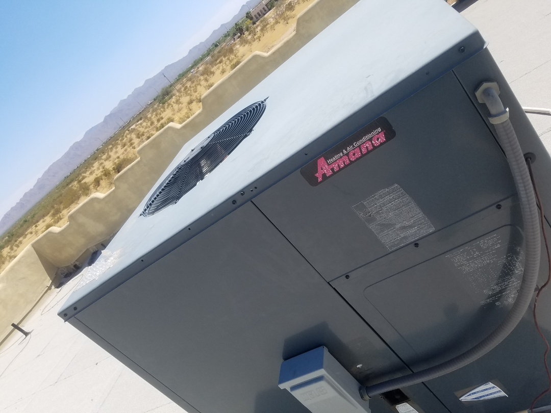 Wittmann, AZ - Doing a tune up and condenser coil cleaning on an Amana heat pump package unit.