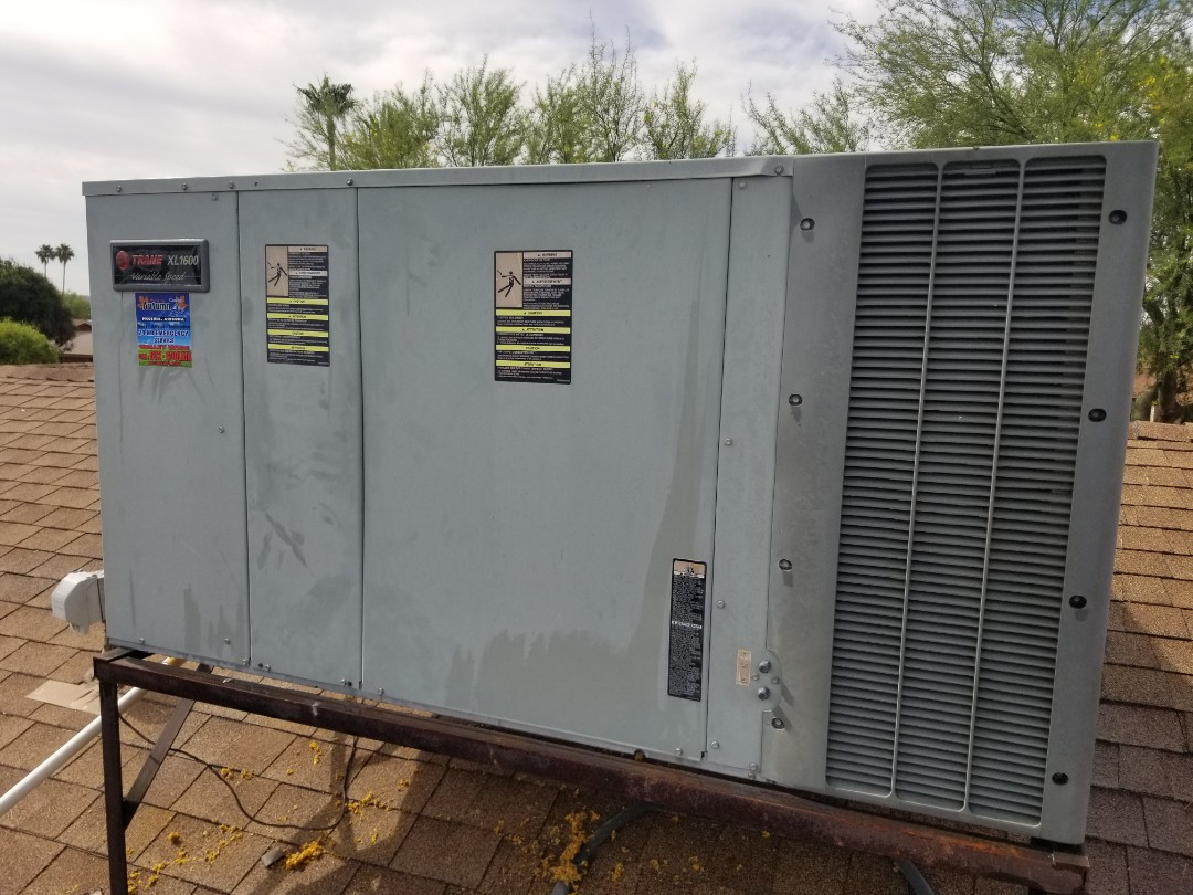 Glendale, AZ - Routine maintenance on a 16seer Trane package heat pump in Glendale.